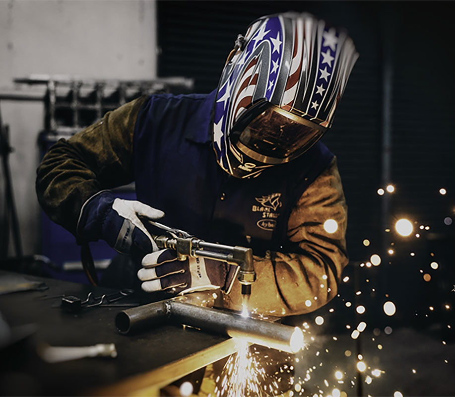 welder working on pipes